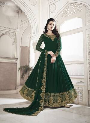 For The Upcoming Wedding And Festive Season, Grab This Heavy Designer Floor Length Suit In Dark Green Color. Its Heavy Embroidered Top and Dupatta Are Fabricated On Georgette Paired With Soft Silk Bottom. Buy Now.