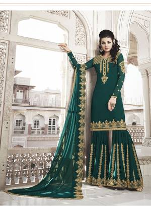 Celebrate This Festive And Wedding Season Wearing This Heavy Designer Suit In Teal Green Color. Its Embroidered Top And Dupatta are Fabricated On Georgette Paired With Soft Silk Fabricated Embroidred Bottom.