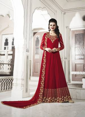 For The Upcoming Wedding And Festive Season, Grab This Heavy Designer Floor Length Suit In Red Color. Its Heavy Embroidered Top and Dupatta Are Fabricated On Georgette Paired With Soft Silk Bottom. Buy Now.