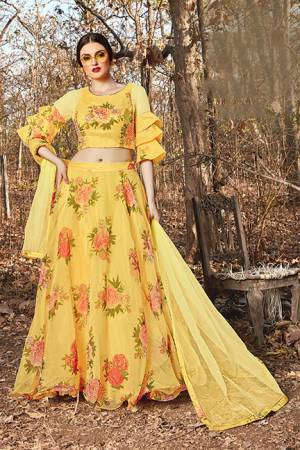 Grab This Pretty Designer Lehenga Choli In Yellow Color. Its Blouse And Lehenga Are Fabricated on Orgenza Beautified With Floral Prints Paired With Net Fabricated Dupatta.