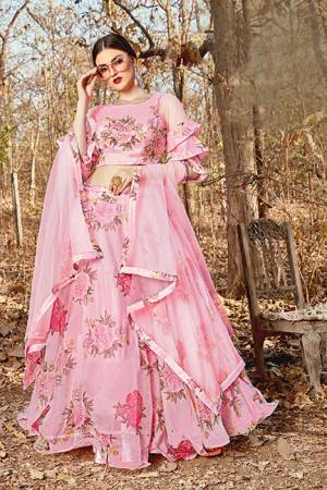 Grab This Pretty Designer Lehenga Choli In Light Pink Color. Its Blouse And Lehenga Are Fabricated on Orgenza Beautified With Floral Prints Paired With Net Fabricated Dupatta.