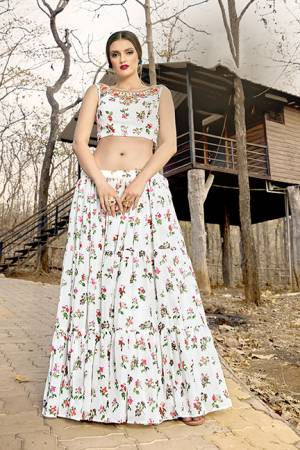 Here Is A Pretty Pair Of Crop Top And Skirt In White Color. This Pretty Printed Crop Top And Skirt Are Georgette Based Which Is Light In Weight And Easy To Carry All Day Long.