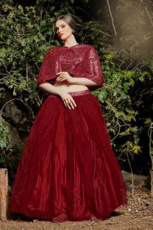 Catch All The Limelight At The Next Function You Attend Wearing This Designer Readymade Pair Of Crop Top And Skirt In Maroon Color. This Top Is Imported Fabric Based Paired With Net Fabricated Skirt.