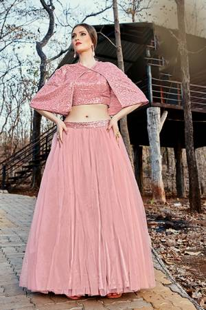 Catch All The Limelight At The Next Function You Attend Wearing This Designer Readymade Pair Of Crop Top And Skirt In Baby Pink Color. This Top Is Imported Fabric Based Paired With Net Fabricated Skirt.