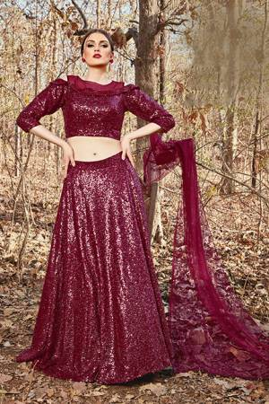 Catch All The Limelight At The Next Function You Attend Wearing This Designer Readymade Lehenga Choli In Maroon Color. Its Blouse And Lehenga Are Imported Fabric Based Paired With Net Fabricated Dupatta.