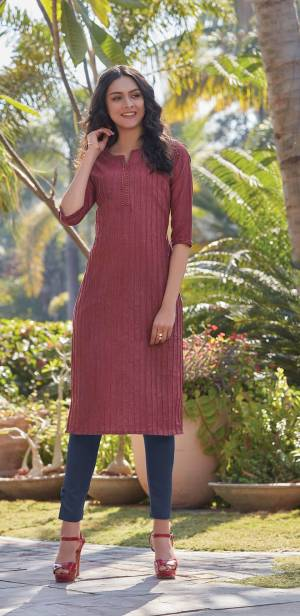 Here Is A Pretty Simple And Elegant Straight Kurti In Maroon Color For Your Casual Or Semi-Casual Wear. It Is Fabricated On South Cotton And You Can Pair This Up With Leggings, Plazzo Or Pants. This Readymade Kurti Is Available In All Regular Sizes.