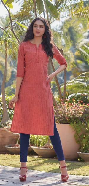 Here Is A Pretty Simple And Elegant Straight Kurti In  Dark Peach Color For Your Casual Or Semi-Casual Wear. It Is Fabricated On South Cotton And You Can Pair This Up With Leggings, Plazzo Or Pants. This Readymade Kurti Is Available In All Regular Sizes.