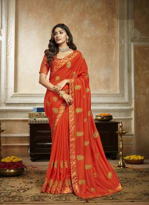 Grab This Pretty Attractive Saree In Orange Color. This Saree Is Fabricated On Soft Art Silk Paired With Brocade Fabricated Blouse. It Has Attractive Jari Embroidered Motifs Highlited With Stone Work. Its Rich Fabric And Color Will Earn You Lots Of Compliments From Onlookers.