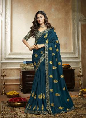 Grab This Pretty Attractive Saree In Blue Color. This Saree Is Fabricated On Soft Art Silk Paired With Brocade Fabricated Blouse. It Has Attractive Jari Embroidered Motifs Highlited With Stone Work. Its Rich Fabric And Color Will Earn You Lots Of Compliments From Onlookers.