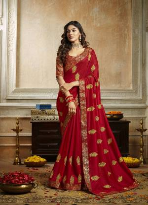 Grab This Pretty Attractive Saree In Red Color. This Saree Is Fabricated On Soft Art Silk Paired With Brocade Fabricated Blouse. It Has Attractive Jari Embroidered Motifs Highlited With Stone Work. Its Rich Fabric And Color Will Earn You Lots Of Compliments From Onlookers.