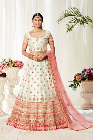 Heavy Designer Lehenga Choli In White and Baby Pink Color Fabricated On Net Beautified With Heavy Attractive Embroidery.