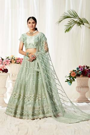 Heavy Designer Lehenga Choli In Pastel Green Color Fabricated On Net Beautified With Heavy Attractive Embroidery.