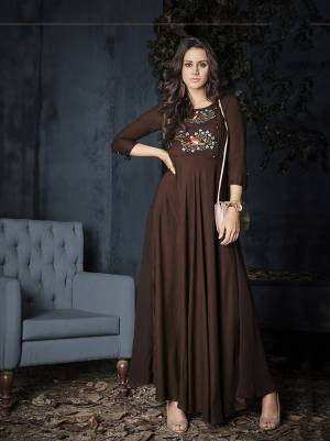 Grab This Readymade Designer Gown In Brown Color For Festive Or Semi-Casuals. This Gown Is Fabricated on Rayon beautified with Thread Work. Also Its Fabric Is Light Weight And Soft Towards Skin.