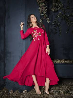 Shine Bright In This Readymade Designer Gown In Dark Pink Color Fabricated On Rayon Beautified With Thread Work. It Has Pretty High Low Pattern And You can Wear It As it Is Or Pair Up With A Leggings. Buy Now.
