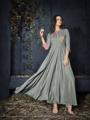Rich And Elegant Looking Designer Readymade Gown Is Here In Grey Color Fabricated On Rayon. It Is Beautified With Contrasting Thread Work Over The Yoke. Buy This Pretty Comfortable Gown Now.