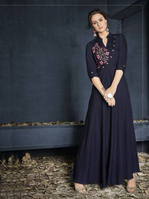 Enhance Your Personality Wearing This Readymade Designer Gown In Navy Blue Color Fabricated On Rayon.This Pretty Gown Has Pretty Thread Work Over The Yoke. It Is Light In Weight And Ensures Superb Comfort All Day Long.