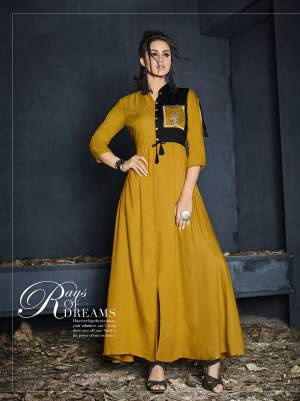 Celebrate This Festive Season Wearing This Designer Readymade Gown In Musturd Yellow Color Fabricated On Rayon. It Is Beautified With Minimal Thread Work. Also It Is Light Weight Which Lets You Enjoy Your Festive Feels Comfortably.