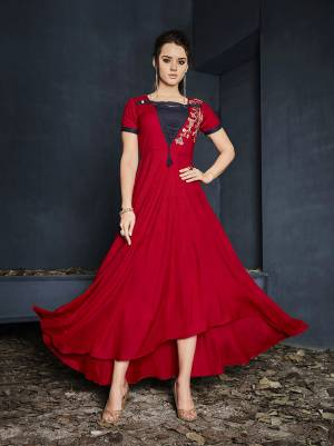 Shine Bright In This Readymade Designer Gown In Red Color Fabricated On Rayon Beautified With Thread Work. It Has Pretty High Low Pattern And You can Wear It As it Is Or Pair Up With A Leggings. Buy Now.
