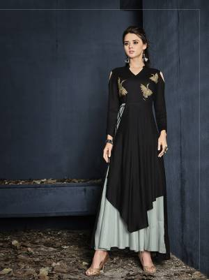New And Unqiue Double Layered Pattern Is Here With This Designer Readymade Gown In Black And Grey Color Fabricated On Rayon. This Gown IS Beautified With Thread Work Over The Yoke And Its Lovely Pattern Will Earn You Lots Of Compliments From Onlookers.