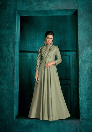 This Season Is About Subtle Shades And Pastel Play, So Grab This Very Pretty Designer Readymade Gown In Pastel Green Color Fabricated On Soft Art Silk. It Has Very Beautiful Pattern On Yoke And Sleeve With Pretty Embroidery Work.
