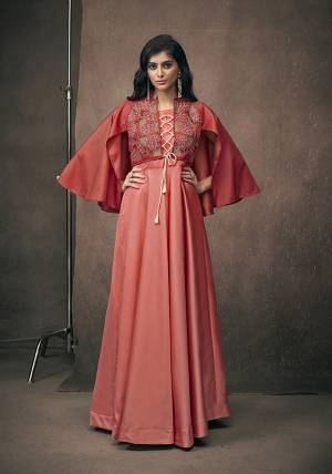 Adorn The Pretty Angelic Look, Wearing This Heavy Designer Readymade Gown In Red Color Fabricated On Satin Silk. Its Is Beautified with Attractive Embroidery Over Yoke With Bell Sleeve Pattern.