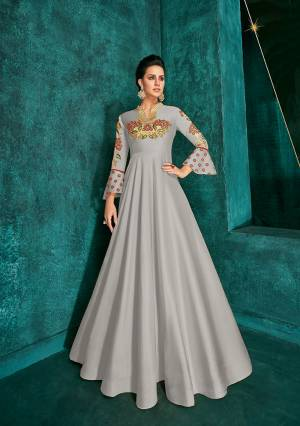 Celebrate This Festive Season Wearing This Designer Readymade Gown In Grey Color Fabricated On Soft Art Silk Beautified With Embroidery. Its Rich Fabric And Color Will Definitely Earn You Lots Of Compliments From Onlookers.?
