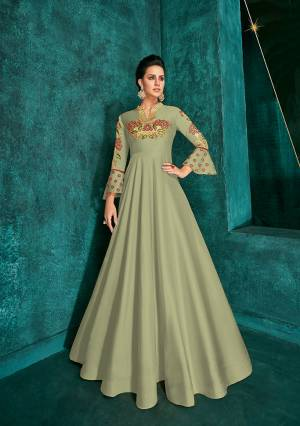 Celebrate This Festive Season Wearing This Designer Readymade Gown In Pastel Green Color Fabricated On Soft Art Silk Beautified With Embroidery. Its Rich Fabric And Color Will Definitely Earn You Lots Of Compliments From Onlookers.?