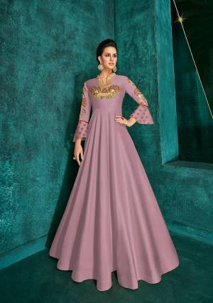 Celebrate This Festive Season Wearing This Designer Readymade Gown In Mauve Pink Color Fabricated On Soft Art Silk Beautified With Embroidery. Its Rich Fabric And Color Will Definitely Earn You Lots Of Compliments From Onlookers.?
