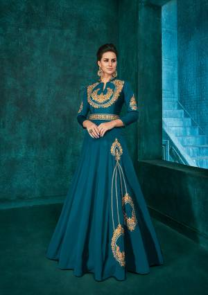 Bright And Visually Appealing Color Is Here With This Very Beautiful Designer Readymade Gown In Blue Color Fabricated Soft Art Silk. It Is Beautified With Minimal Elegant Looking Embroidery Which Will Earn You Lots Of Compliments From Onlookers