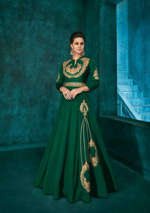 Bright And Visually Appealing Color Is Here With This Very Beautiful Designer Readymade Gown In Dark Green Color Fabricated Soft Art Silk. It Is Beautified With Minimal Elegant Looking Embroidery Which Will Earn You Lots Of Compliments From Onlookers