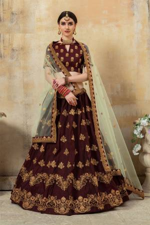 For A Bold And Beautiful Look, Grab This Very Beautiful And Attractive Lehenga Choli In Maroon Color Paired With Cream Colored Dupatta. Its Blouse And Lehenga Are Silk Based Paired With Net Fabricated Dupatta. Buy Now.