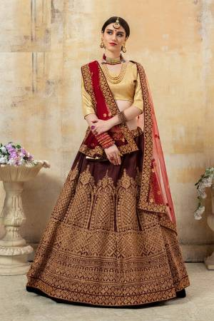 Grab This Attractive Looking Heavy Designer Lehenga Choli In Golden Colored Blouse Paired With Maroon Colored Lehenga And Dupatta. This Pretty Lehenga Choli Is Based Paired With Net Fabricated Dupatta. Buy This Pretty Piece Now.