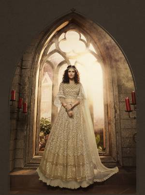 Here Is A Beautiful Lehenga Choli In All Over Beige Color. Thisw Pretty Heavy Embroidered Lehenga Choli Is Net Based Beautified With Heavy Detailed Embroidery. Its Attractive Embroidery And Rich Color Will Definitely Earn You Lots Of Compliments From Onlookers.