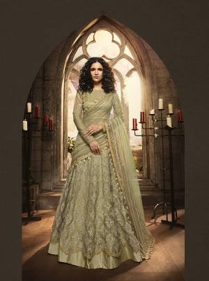 This Season Is About Subtle Shades And Pastel Play, So Grab This Heavy Designer Lehenga Choli In Pastel Green Color Paired With Pastel Green Colored Dupatta. It Is Beautified With Heavy Contrasting Embroidery And Jari Work. Buy This Pretty Piece Now.