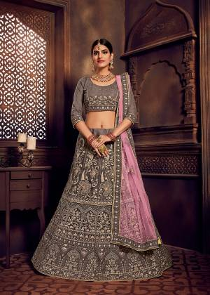 Rich And Elegant Looking Heavy Designer Lehenga Choli Is Here In Lovely Grey Color Paired With Contrasting Lilac Colored Dupatta. This Pretty Heavy Embroidered Lehenga Choli And Dupatta Are Fabricated On Net. Buy Now.