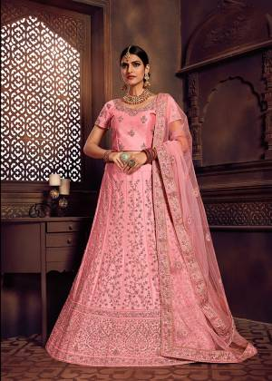 Look Pretty In This Heavy Designer Lehenga Choli In All Over Pink Color. Its Blouse And Lehenga Are Fabricated On Art Silk Paired With Net Fabricated Dupatta. It Is Beautified With Heavy Embroidery Giving It An Attractive Look.