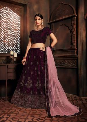 You Will Definitely Earn Lots Of Compliments In This Elegant Looking Designer Lehenga Choli In Wine Color Paired With Pink Colored Dupatta. This Beautiful Lehenga Choli Is Fabricated On Velvet Paired With Net Fabricated Dupatta. It Is Beautified With Attractive Stone Work All Over.