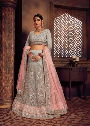 Rich And Elegant Looking Heavy Designer Lehenga Choli Is Here In Lovely Light Grey Color Paired With Contrasting Pastel Pink Colored Dupatta. This Pretty Heavy Embroidered Lehenga Choli And Dupatta Are Fabricated On Net. Buy Now.