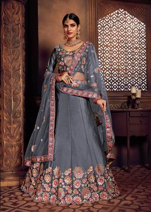 Look Pretty In This Heavy Designer Lehenga Choli In All Over Grey Color. Its Blouse And Lehenga Are Fabricated On Art Silk Paired With Net Fabricated Dupatta. It Is Beautified With Heavy Embroidery Giving It An Attractive Look.
