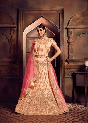 Add This Beautiful Lehenga Choli To Your Wardrobe For This Festive Season With This Lovely Light Peach Colored Lehenga Choli Paired With Contrasting Pink Colored Dupatta. This Lehenga Choli Is Silk Based Paired With Net Fabricated Dupatta. Buy Now.