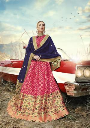 Go With Pretty Shades Wearing This Heavy Weaved Designer?Lehenga Choli In Rani Pink Color Paired With Contrasting Navy Blue Colored Dupatta. Its Blouse Is Fabricated On Banarasi Art Silk Paired With Banarasi Jacquard Silk Lehenga And Dupatta
