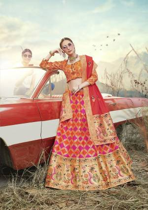 Look Pretty In This Designer Silk Based Lehenga Choli In Orange Color Paired With Contrasting Red Colored Dupatta. It Is Fabricated On Banarasi Jacquard Silk Beautified With Weave All Over. Buy This Pretty Piece Now.?