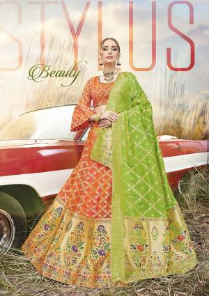 Shine Bright In This Very Beautiful Designer Lehenga Choli In Orange Color Paired With Contrasting Parrot Green Colored Dupatta. This Lehenga Choli Is Fabricated On Banarasi Jacquard Silk Beautified With Weave All Over.