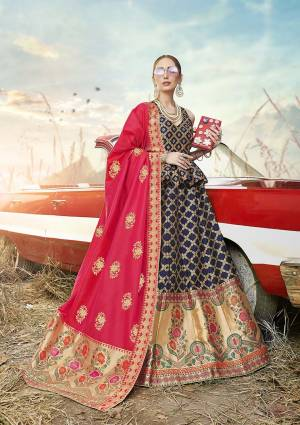 Look Pretty In This Designer Silk Based Lehenga Choli In Navy Blue Color Paired With Contrasting Rani Pink Colored Dupatta. It Is Fabricated On Banarasi Jacquard Silk Beautified With Weave All Over. Buy This Pretty Piece Now.?