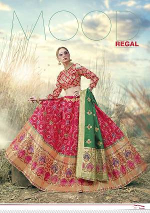 Shine Bright In This Very Beautiful Designer Lehenga Choli In Rani Pink Color Paired With Contrasting Green Colored Dupatta. This Lehenga Choli Is Fabricated On Banarasi Jacquard Silk Beautified With Weave All Over.