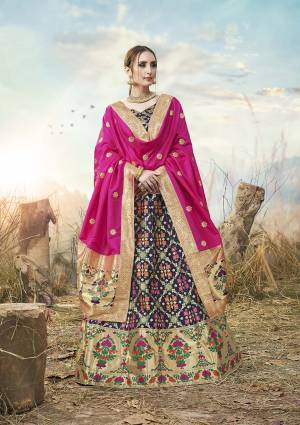 Go With Pretty Shades Wearing This Heavy Weaved Designer?Lehenga Choli In Navy Blue Color Paired With Contrasting Rani Pink Colored Dupatta. Its Blouse Is Fabricated On Banarasi Art Silk Paired With Banarasi Jacquard Silk Lehenga And Dupatta