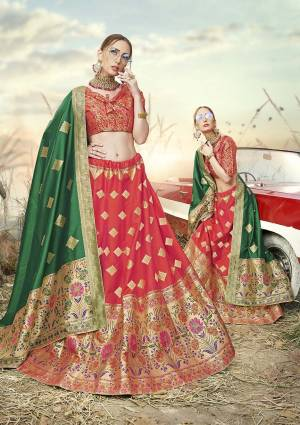 Shine Bright In This Very Beautiful Designer Lehenga Choli In Red And Orange Color Paired With Contrasting Green Colored Dupatta. This Lehenga Choli Is Fabricated On Banarasi Jacquard Silk Beautified With Weave All Over.