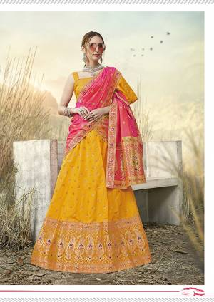 Go With Pretty Shades Wearing This Heavy Weaved Designer?Lehenga Choli In Musturd Yellow Color Paired With Contrasting Pink Colored Dupatta. Its Blouse Is Fabricated On Banarasi Art Silk Paired With Banarasi Jacquard Silk Lehenga And Dupatta