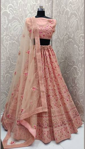 This Wedding Season, Look The Most Graceful Of All Wearing This Heavy Designer Lehenga Choli In Peach Color. Its Blouse, Lehenga And Dupatta are Fabricated on Net Beautified With Tone To Tone Coding Work And Contrasting Resham Embroidery With Stone Work. Buy Now.