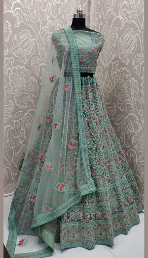 This Wedding Season, Look The Most Graceful Of All Wearing This Heavy Designer Lehenga Choli In Turquoise Blue Color. Its Blouse, Lehenga And Dupatta are Fabricated on Net Beautified With Tone To Tone Coding Work And Contrasting Resham Embroidery With Stone Work. Buy Now.